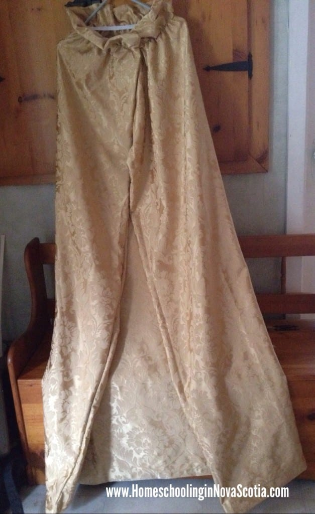 make a cape out of an old curtain